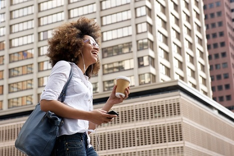 Smiling african american woman walking